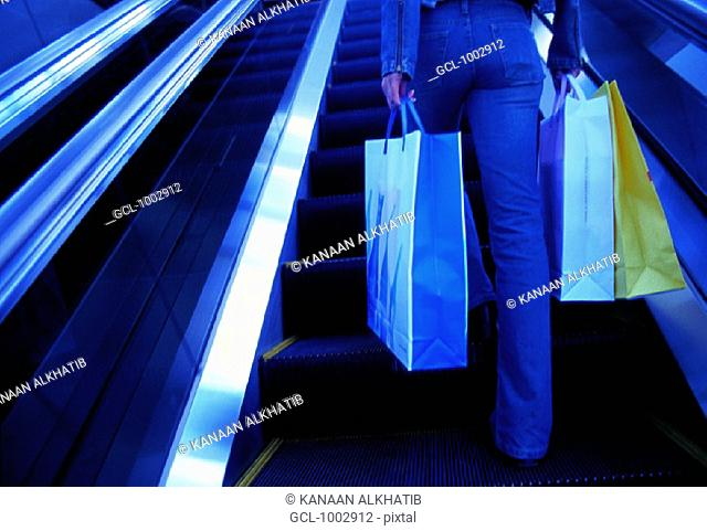 Woman with shopping bags in a shopping mall