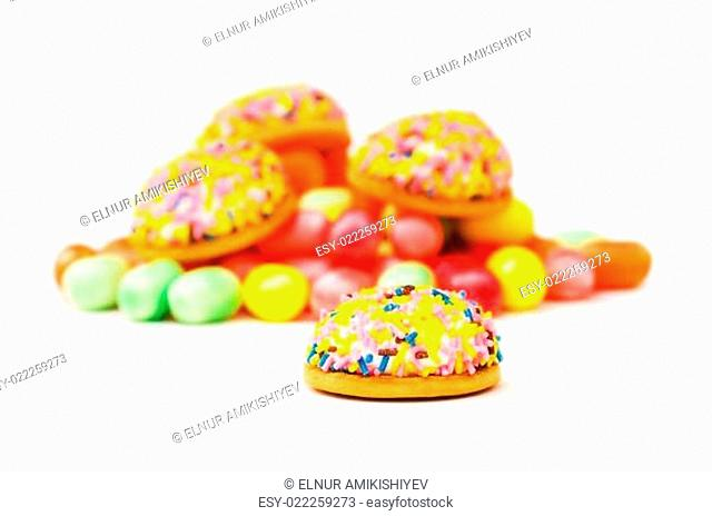 Sweet cakes and colourful gums at the background