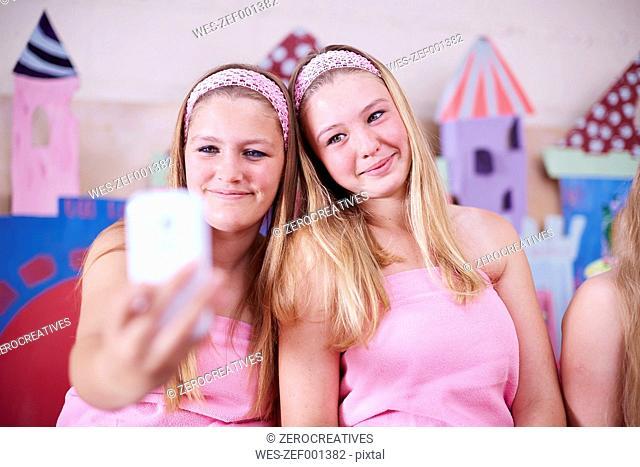 Two girls on a beauty farm taking a selfie
