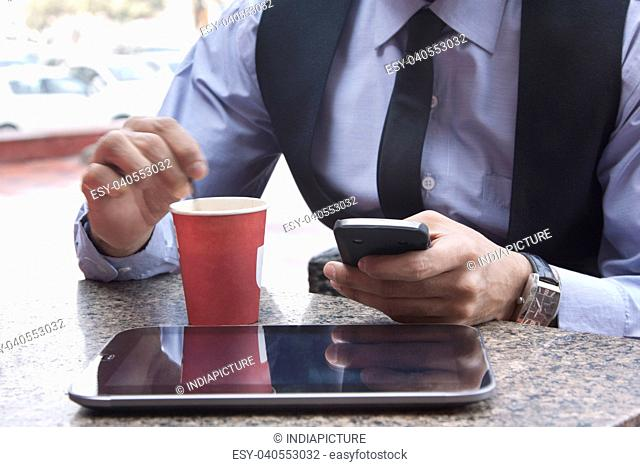 Close-up of digital tablet , coffee and mobile phone , INDIA , DELHI