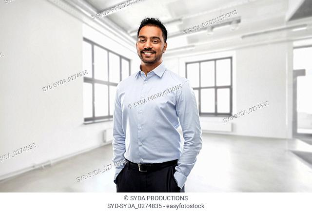 indian businessman or realtor in empty office room