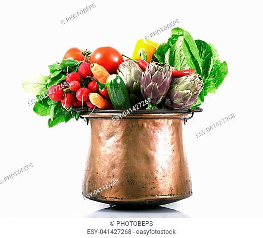 a background of fresh vegetables in pot