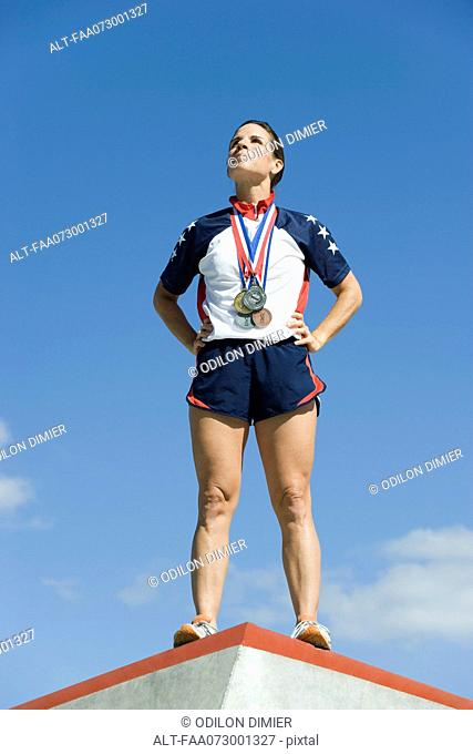 Female athlete standing on winner's podium