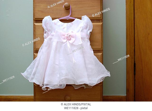 Pretty pink party dress for a baby girl