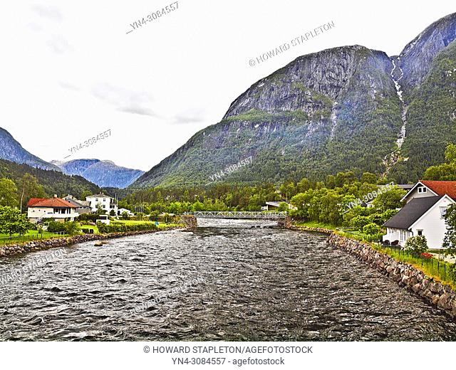 A utility bridge across the Eio River in the village of Eidfjord, Norway. The Eio river is only 1. 3 miles long and runs from Lake Eidfjord into the Eid Fjord...