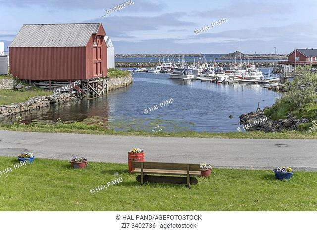 ANDENES, NORWAY - July 11 2019: cityscape with bench looking at village harbor, shot under brightsummer light on july 11, 2019 at Andenes, Andoya, Vesteralen
