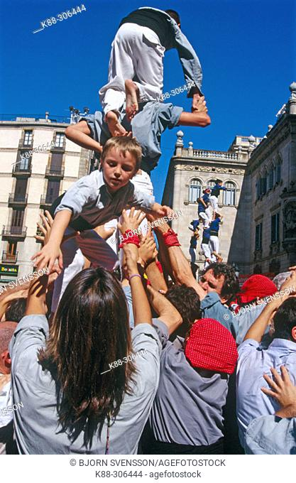 'Castellers' building human towers, a Catalan tradition. Barcelona. Spain