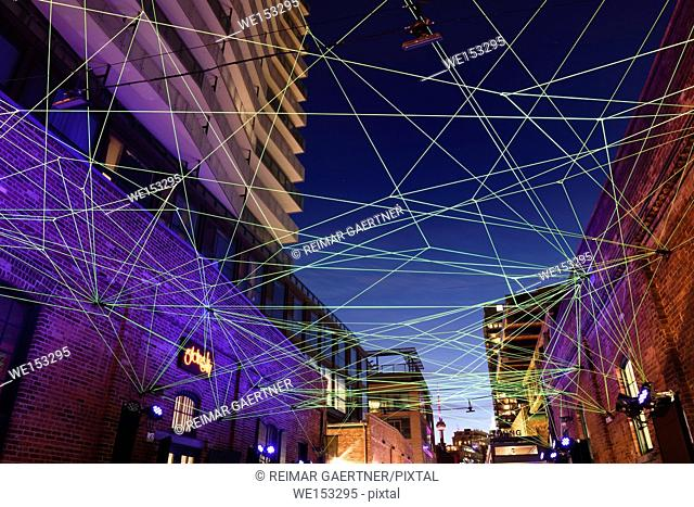 Green fiber optic cables for art installation at Toronto Light Festival at Distillery District with CN Tower