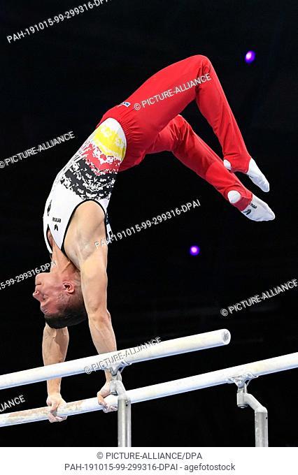 13 October 2019, Baden-Wuerttemberg, Stuttgart: Gymnastics: World Championships, apparatus finals, men: Lukas Dauser from Germany performs on bars