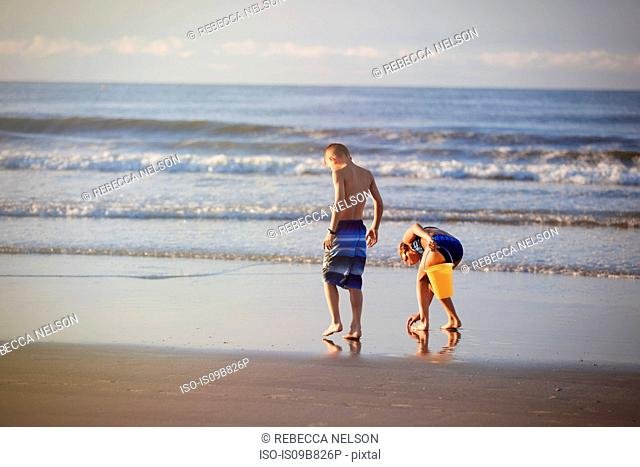 Girl and boy on beach, North Myrtle Beach, South Carolina, United States, North America