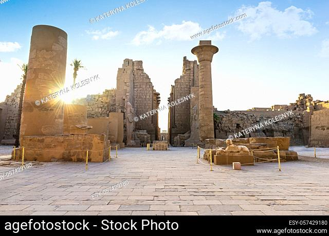 Ruins and statues of Karnak temple in Luxor at sunrise, Egypt