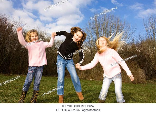 Three jumping girls, 6, 9 and 11 years old