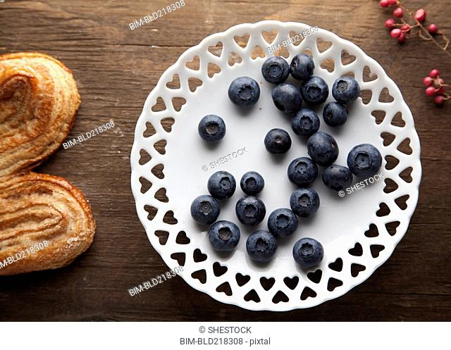 Plate of blueberries with pastry