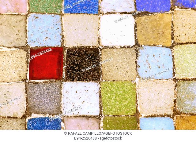Table with colored ceramic tesseras, tesserae or tessella, individual tile, usually formed in the shape of a cube, used in creating a mosaic