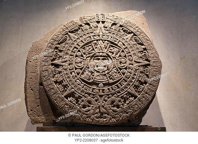 Aztec calendar stone at the National Museum of Anthropology - Miguel Hidalgo, Mexico City, Federal District, Mexico. The museum contains the world's largest...