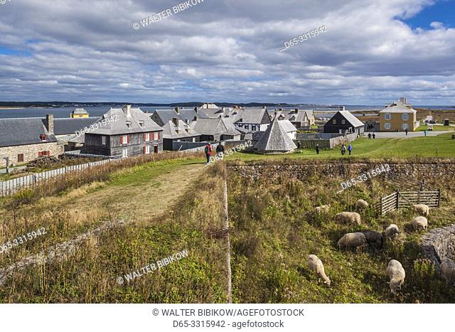 Canada, Nova Scotia, Louisbourg, Fortress of Louisbourg National Historic Park, reconstructed town buildings and sheep pasture