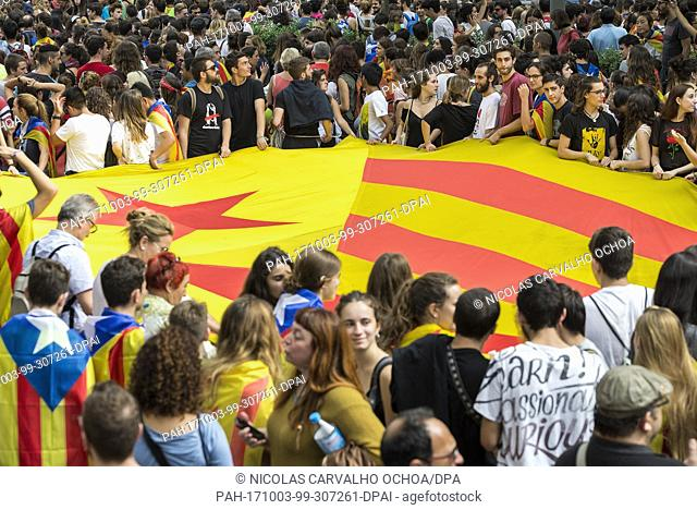 Supporters of Catalan independence holding an Estelada flag during a demonstration in Barcelona, Spain, 3 October 2017. Unions and other organisations called a...