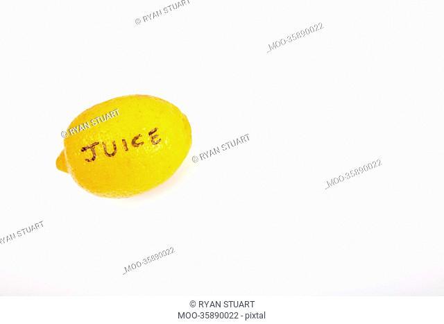 Juicy lemon over white background