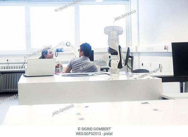 Sudents studying robotic at an university institute
