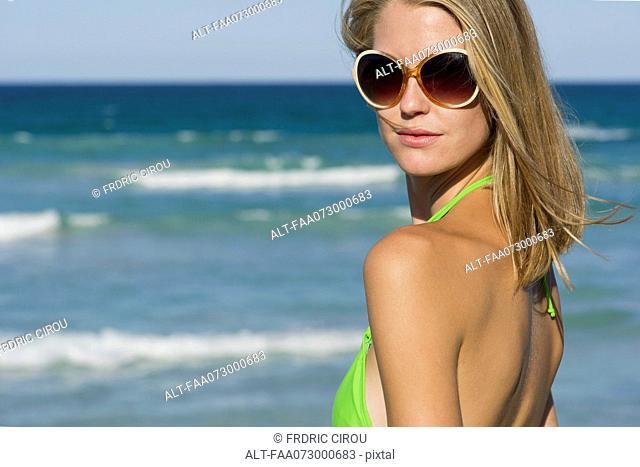 Woman in bikini by sea