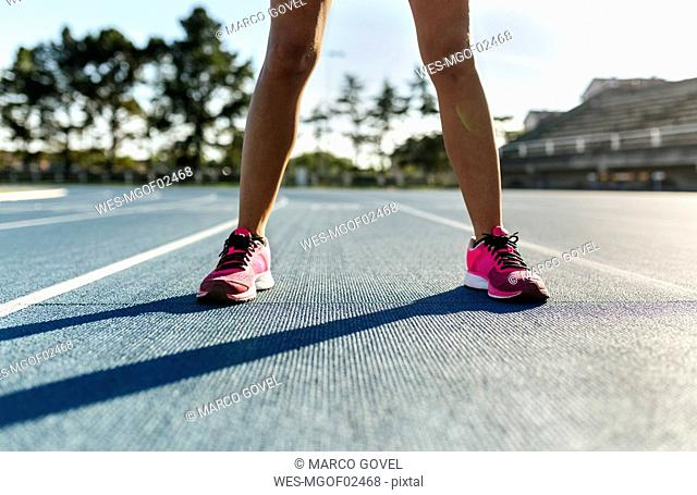 Legs of thlete preparing in stadium for race