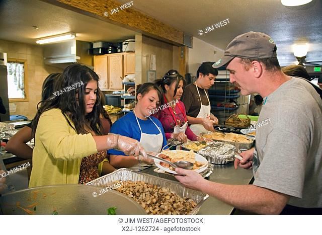 Alamosa, Colorado - High school students from First United Methodist Church in Chula Vista, California cook and serve a meal at a homeless shelter operated by...