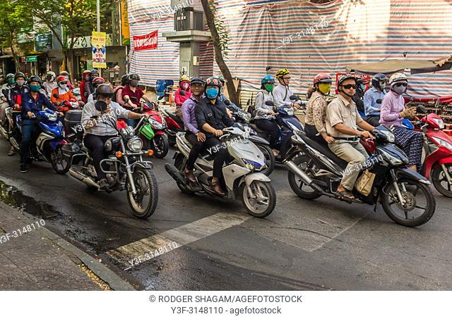 Typical Ho Chi Minh City (Saigon) street scene, crowded with motorcycles of all shapes and sizes