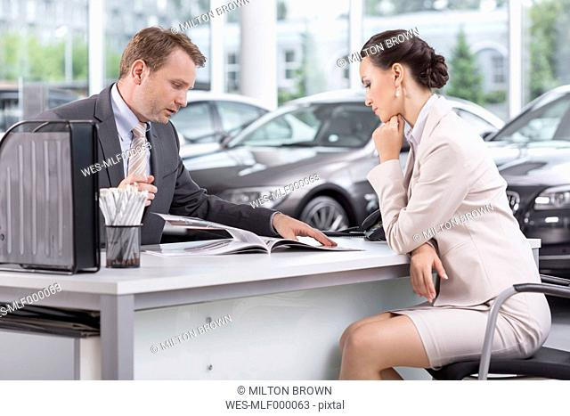 At the car dealer, Salesman talking to client