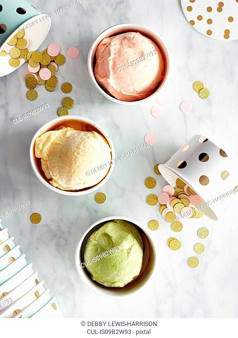 Ice-cream in cups on marble top