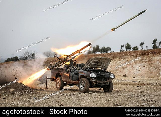 14 February 2020, Syria, Mizanaz: A rocket launcher of the Turkish-backed Syrian fighters launches its missiles amid a massive attack to retake control of the...