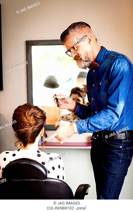 Man working in quirky hair salon