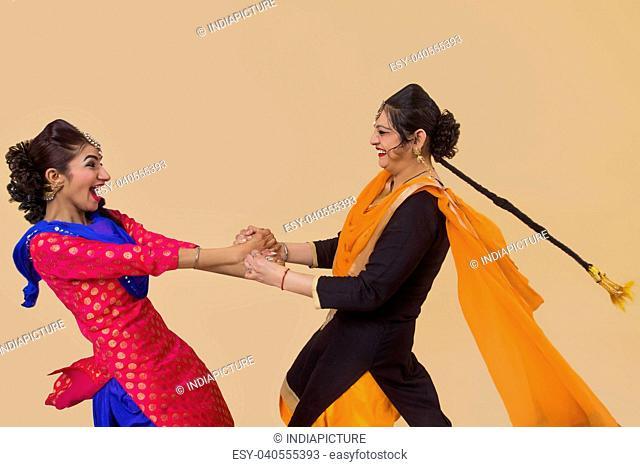 Two Sikh Women playing Kikli game