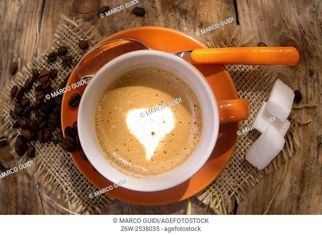 Cup of hot coffee represented with drawings of love hearts