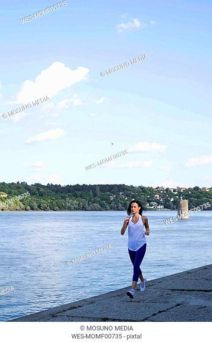 Woman jogging on the river bank, Danube river, Novi Sad, Serbia