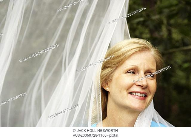 Close-up of a mature woman smiling and looking sideways
