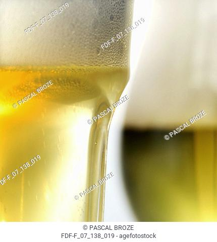Close-up of a glass of white wine and a glass of beer