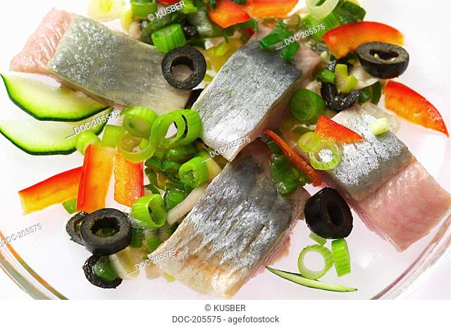 Matjes Hering with olives , cucumber , sweet pepper , shallots