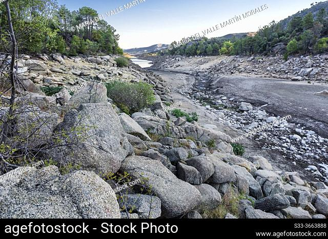 Drought in the Iruelas gorge and Burguillo reservoir at summer time. Avila. Spain. Europe