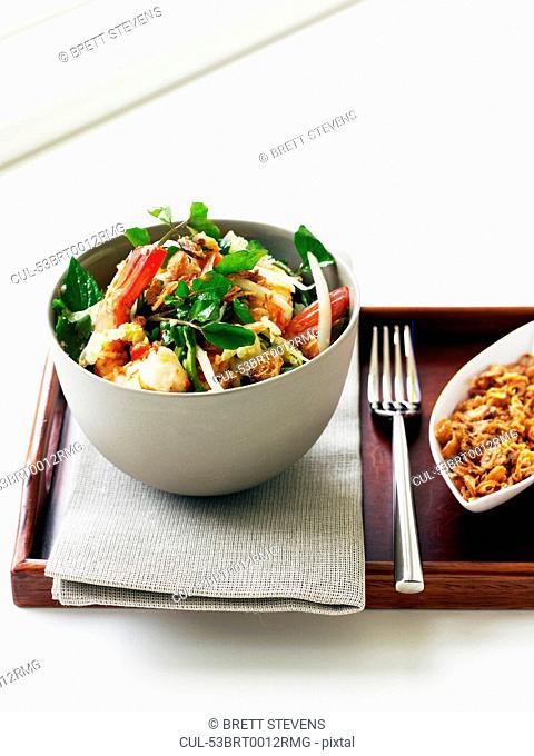 Bowl of prawn and papaya salad