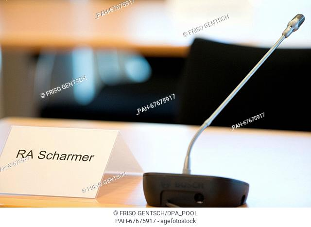 The name plate of lawyer Andreas Scharmer stands on a table on another day of trial against defendant Reinhold Hanning in Detmold, Germany, 22 April 2016
