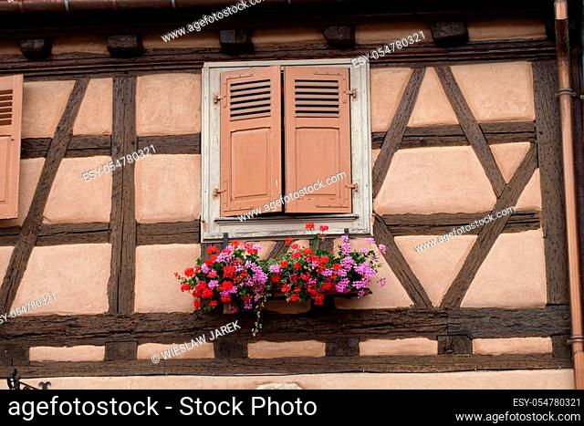Street with half-timbered medieval houses in Eguisheim village along the famous wine route in Alsace, France