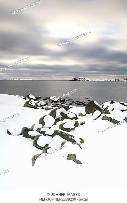 Snow covering coast