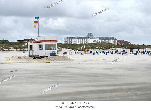 Germany, Lower Saxony, East Frisia, Juist, beach watch with the old Kurhaus, today a hotel (in the background)