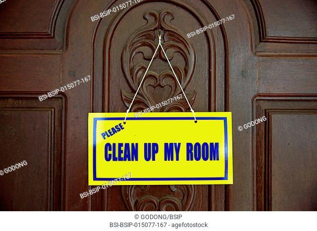 Hotel door. Clean up my room sign