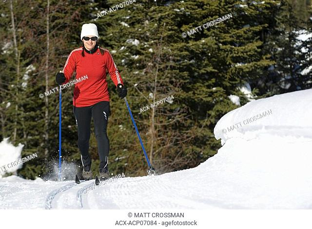Middle-aged woman cross country skiing, Sun Peaks Resort, British Columbia, Canada