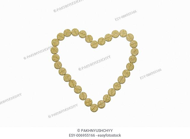Heart from pills on a white background