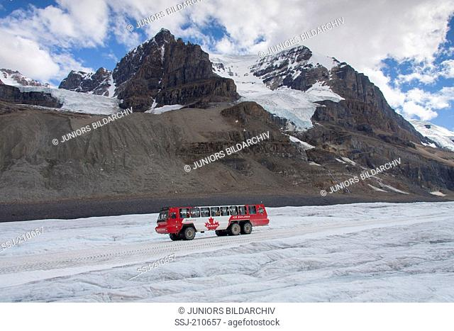 Athabasca Glacier, with Brewster Bus full of Tourists.Jasper National Park, Alberta, Canada
