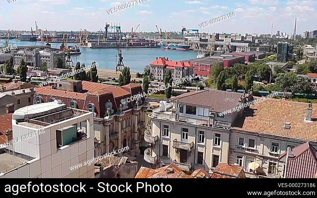 A mix of old and modern buildings in the old town, with the commercial harbor behind, in Constanta, the third largest city in Romania