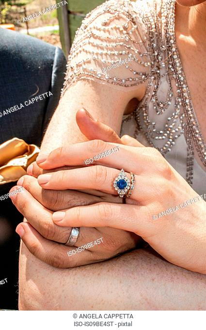 Hands of newlywed couple