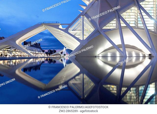 Prince Philip Science Museum reflected in the water at twilight. Valencia, Spain